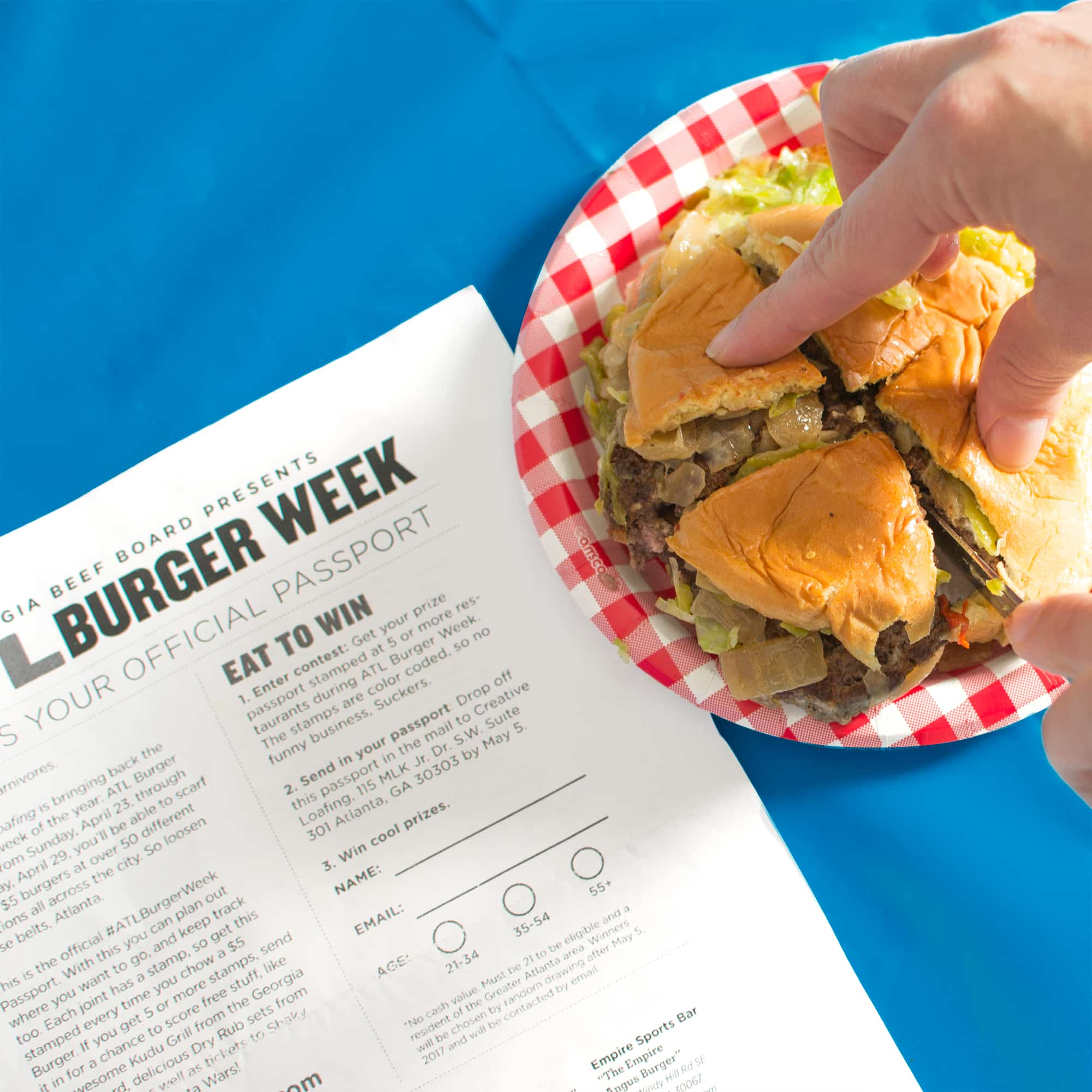 Displaying the Atlanta Burger Week official passport.