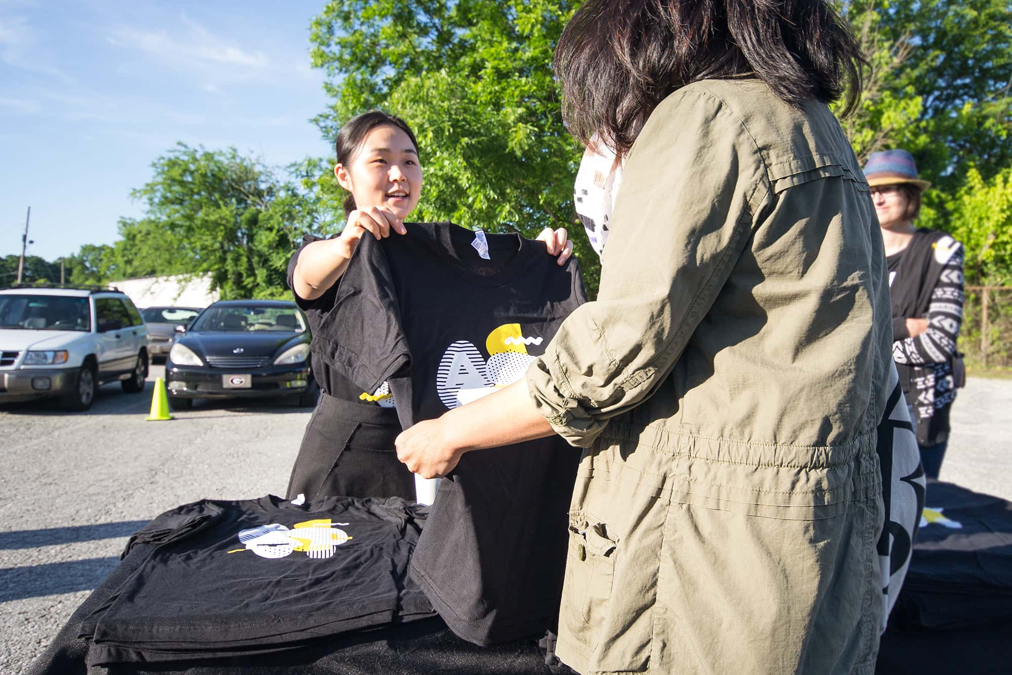 Handing out printed event t-shirts.