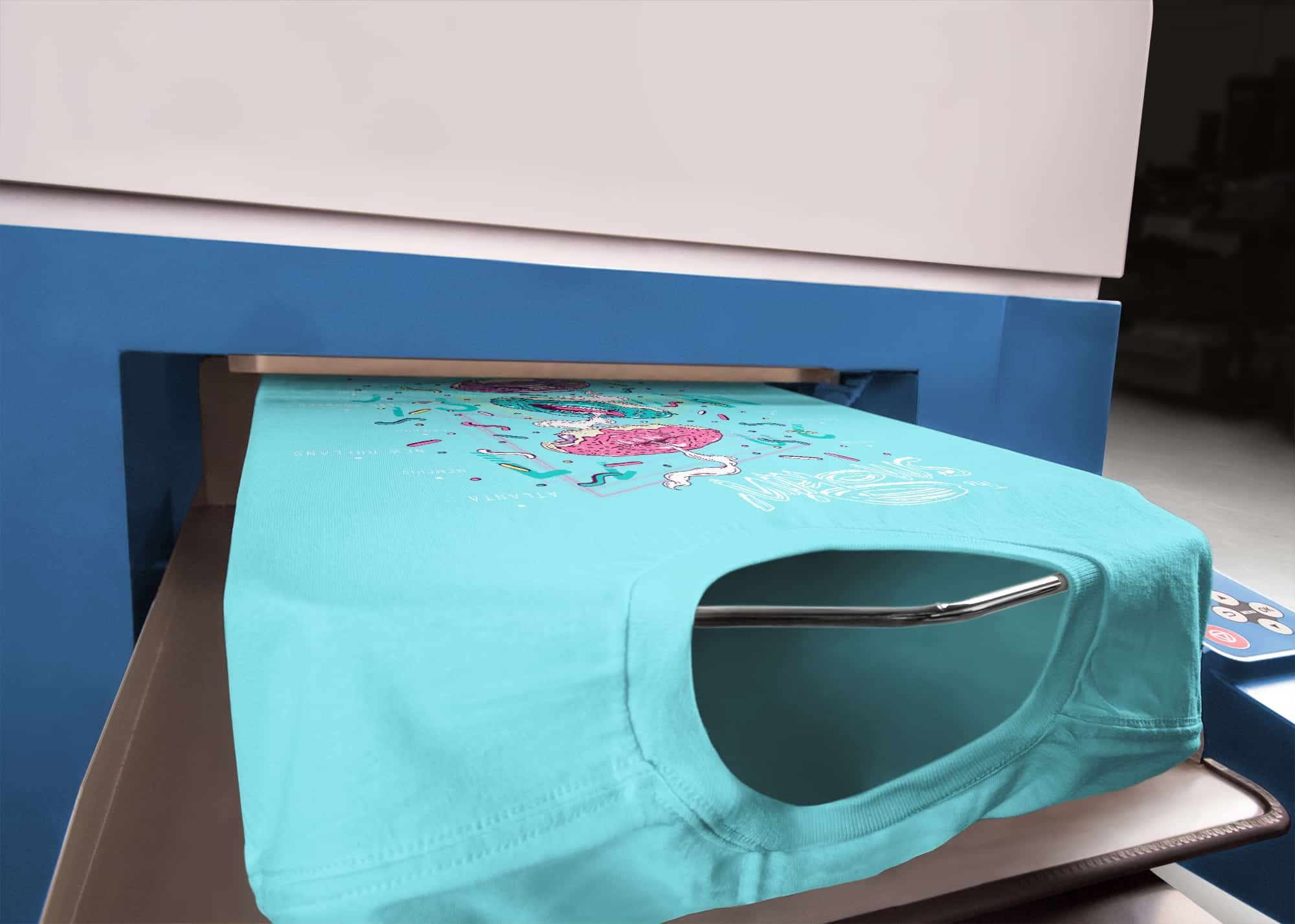 A detail shot of a t-shirt as it exits a direct-to-garment printer.