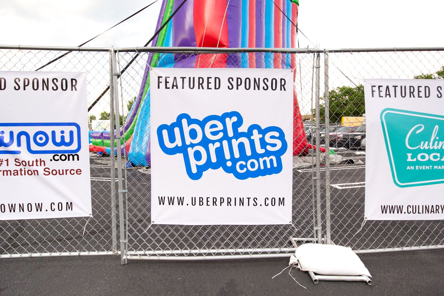 The UberPrints featured sponsor poster outside the International Night Market event.