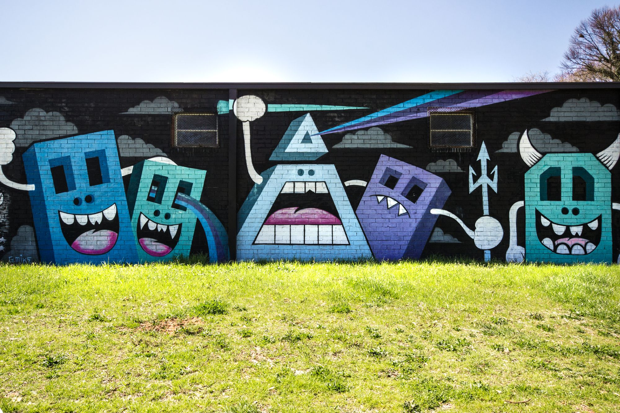 A mural by Greg Mike in his trademark style.