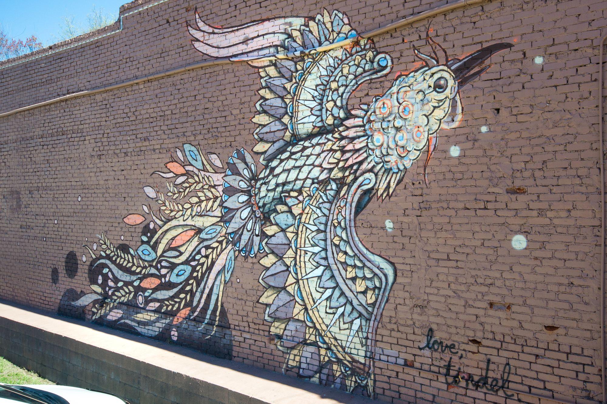 A mural by John Tindel depicting a flying bird.