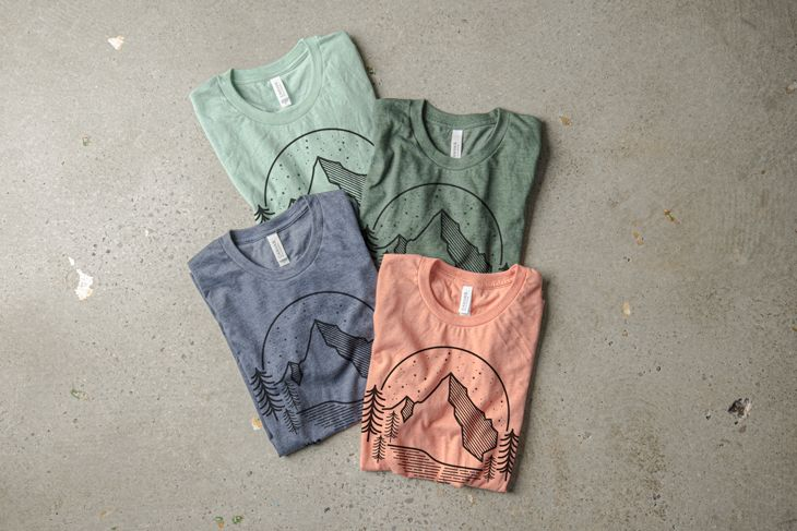 Four t-shirt colors representing the color pallet folded into a display.
