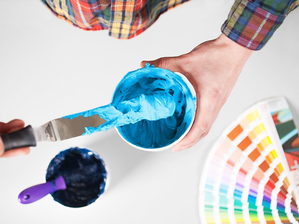 Hand mixing blue plastisol screen printing ink.