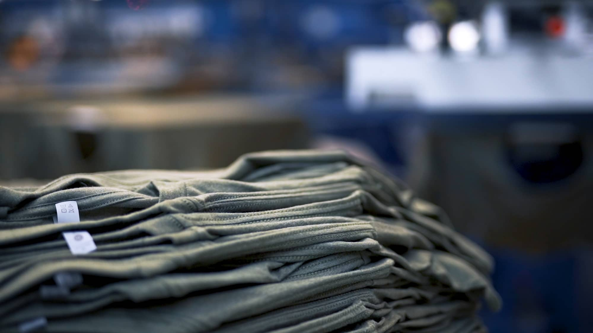 T-shirts staged for printing.