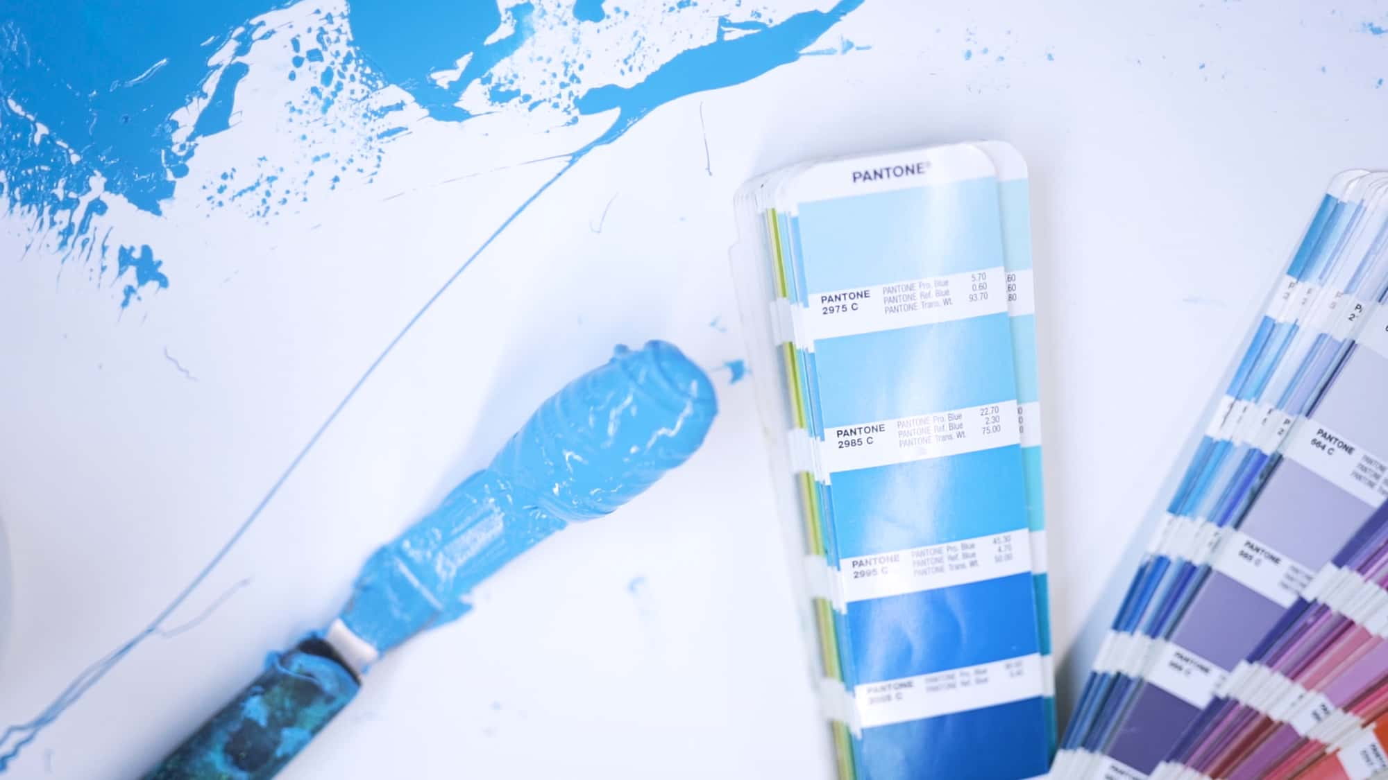 Screen printing ink compared to a matching color swatch.