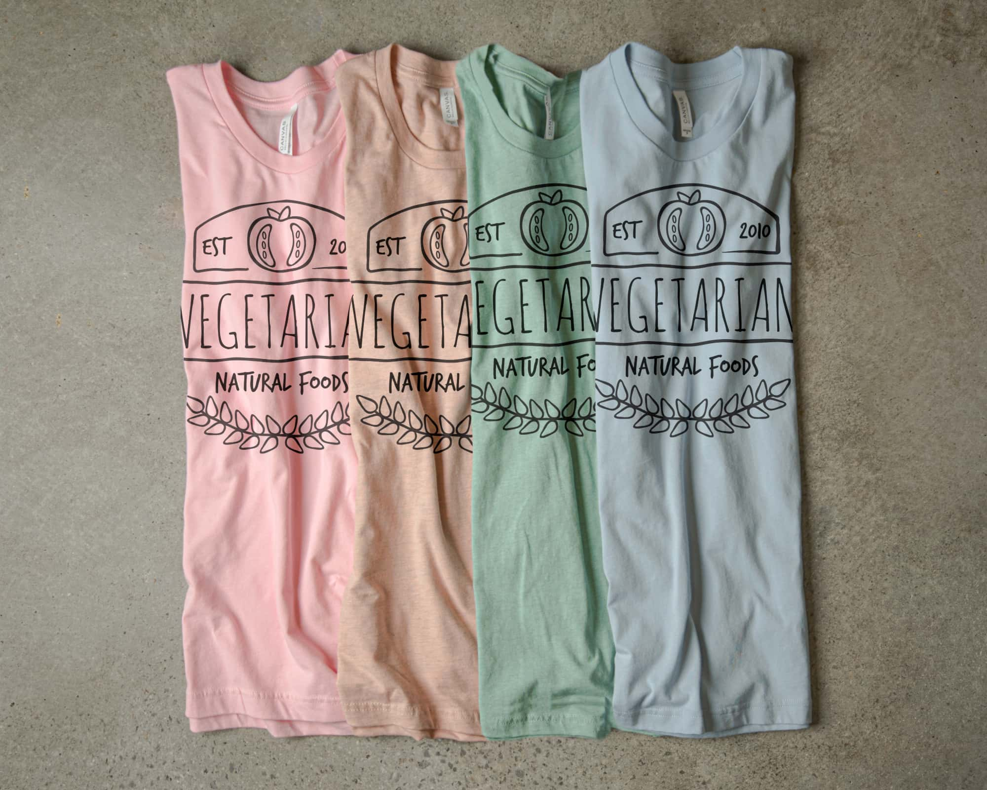 Our pastel color pallet shown in various t-shirt colors with a monochromatic design.