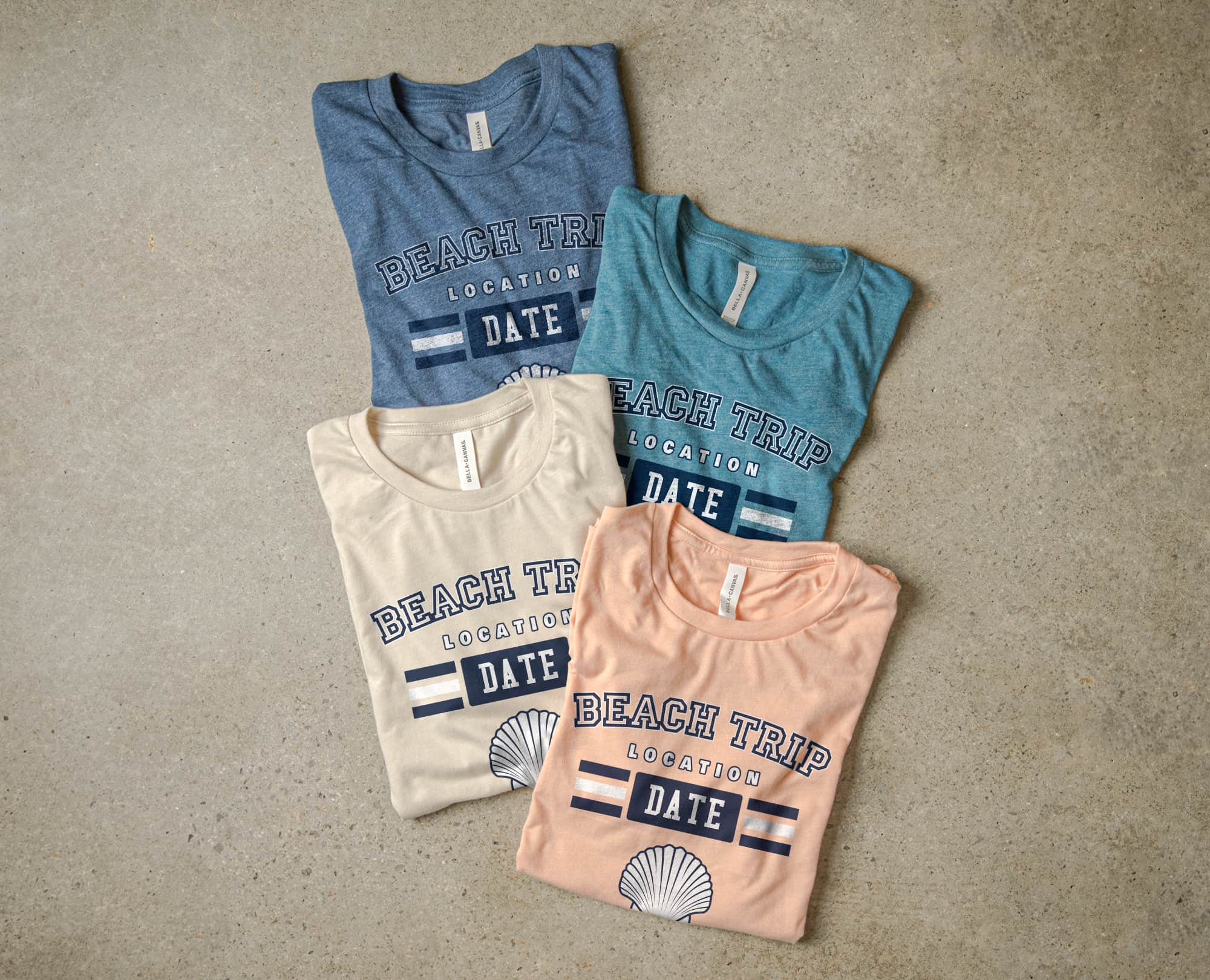 The Bella+Canvas Sueded Tee in four colors with example t-shirt design.