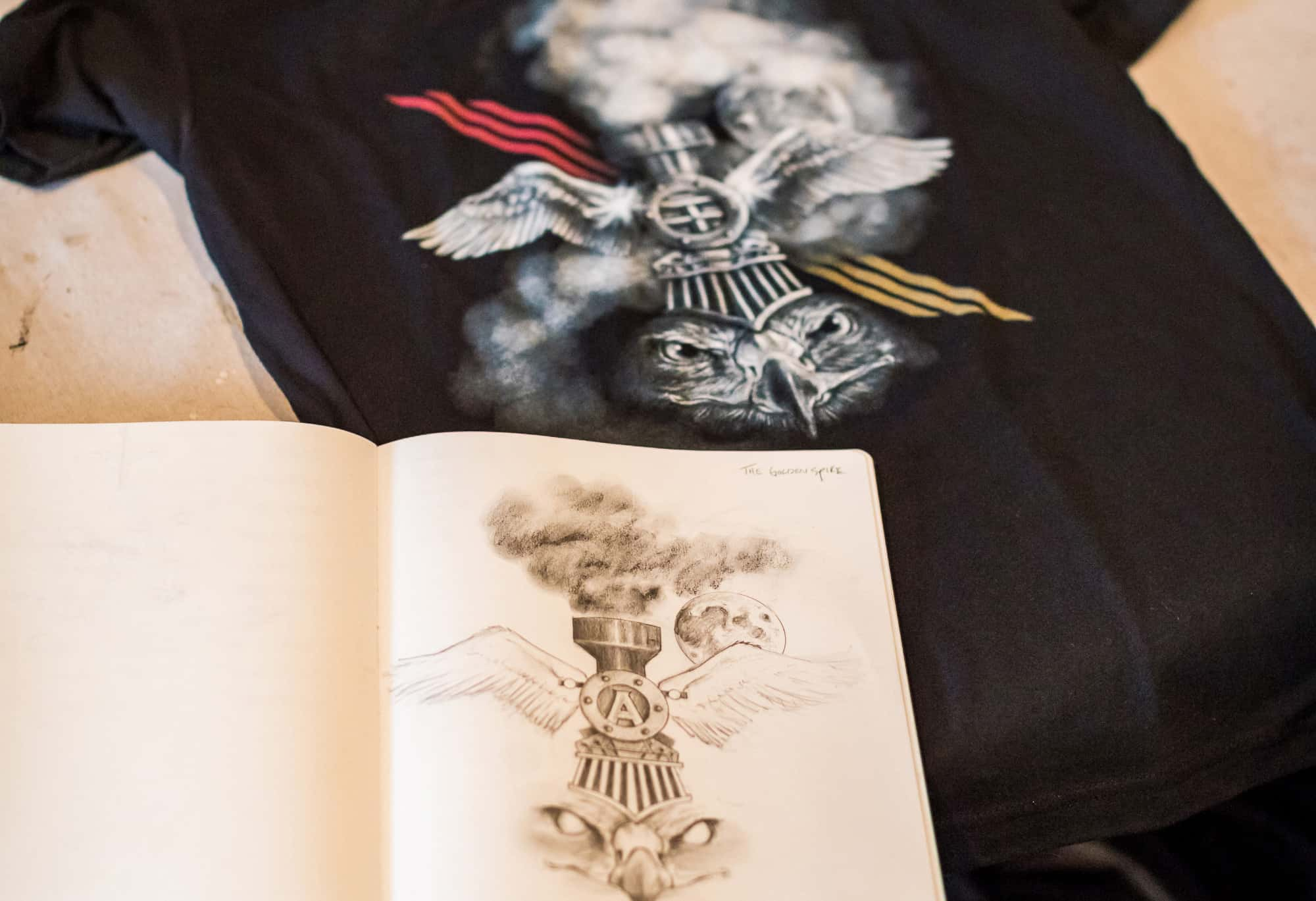 A detail image of Thomas Turner's notebook and printed t-shirt.