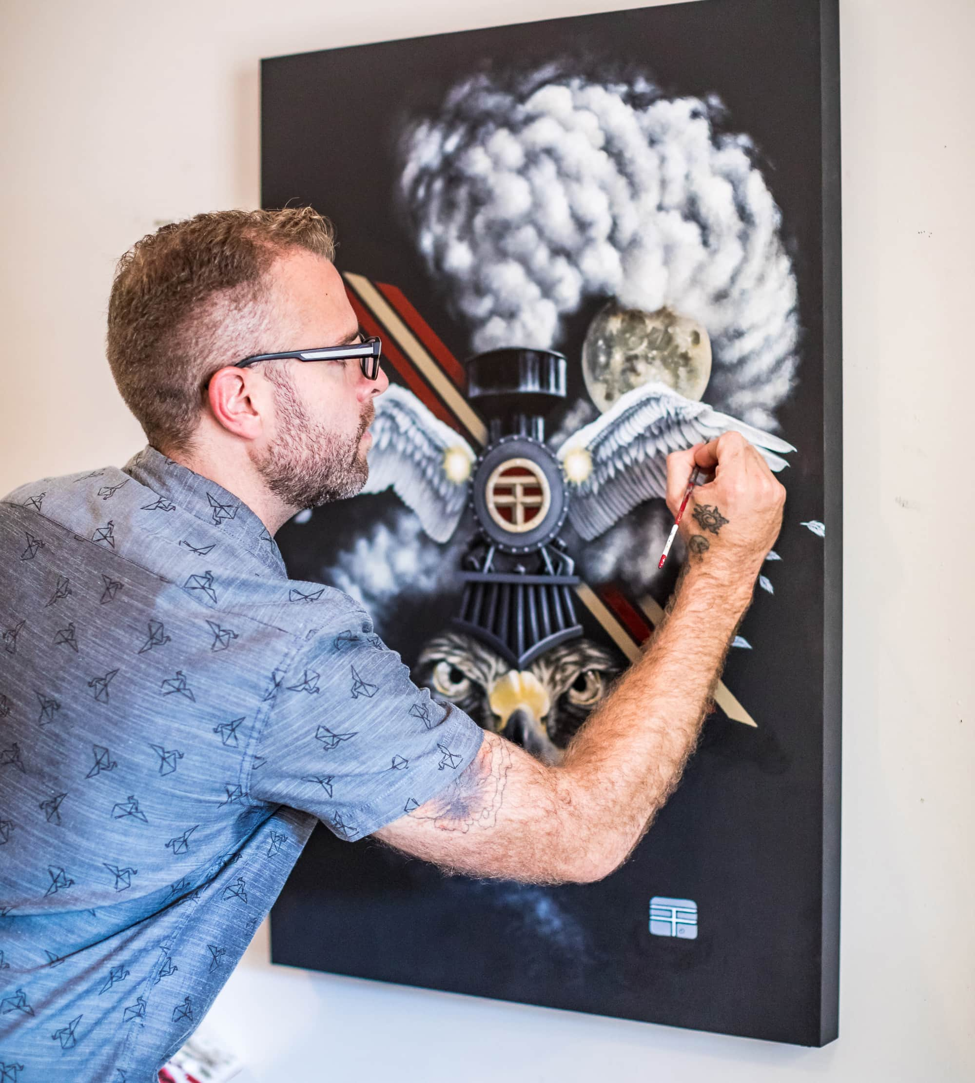 Artist Thomas Turner painting the work that was inspiration for his printed t-shirt.