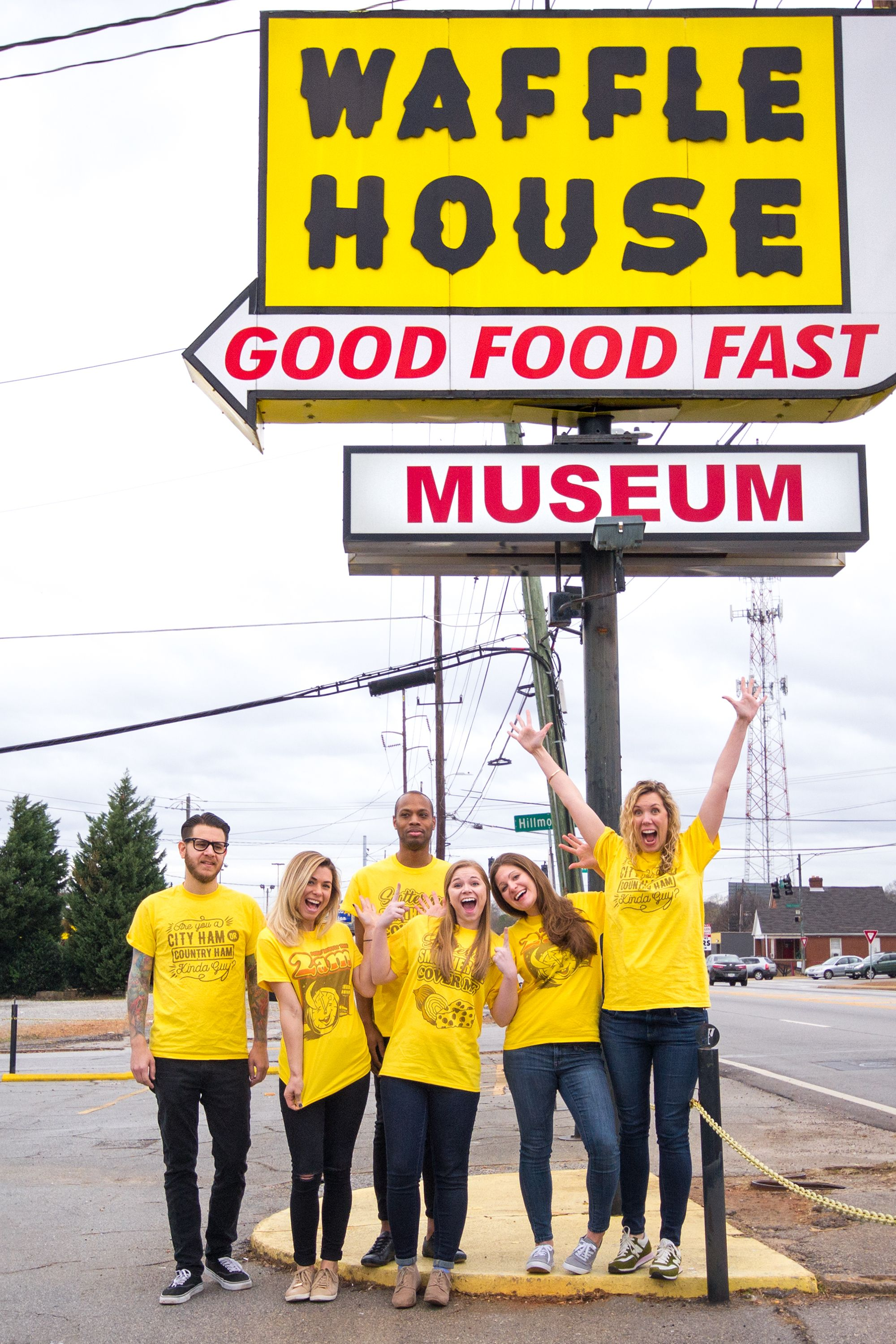 The UberPrints crew posing in front of the Waffle House sign.