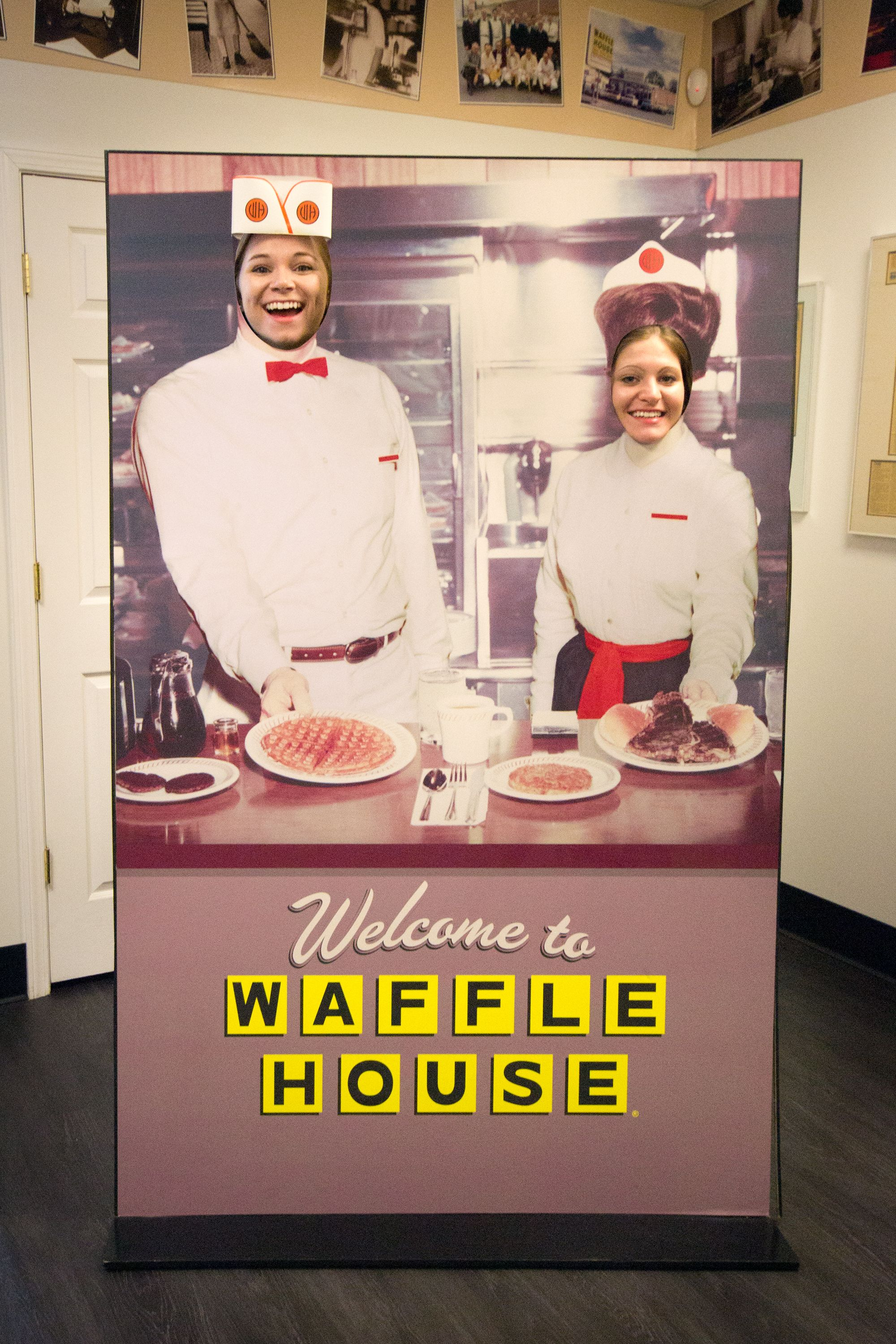 Posing with the Waffle House novelty sign.