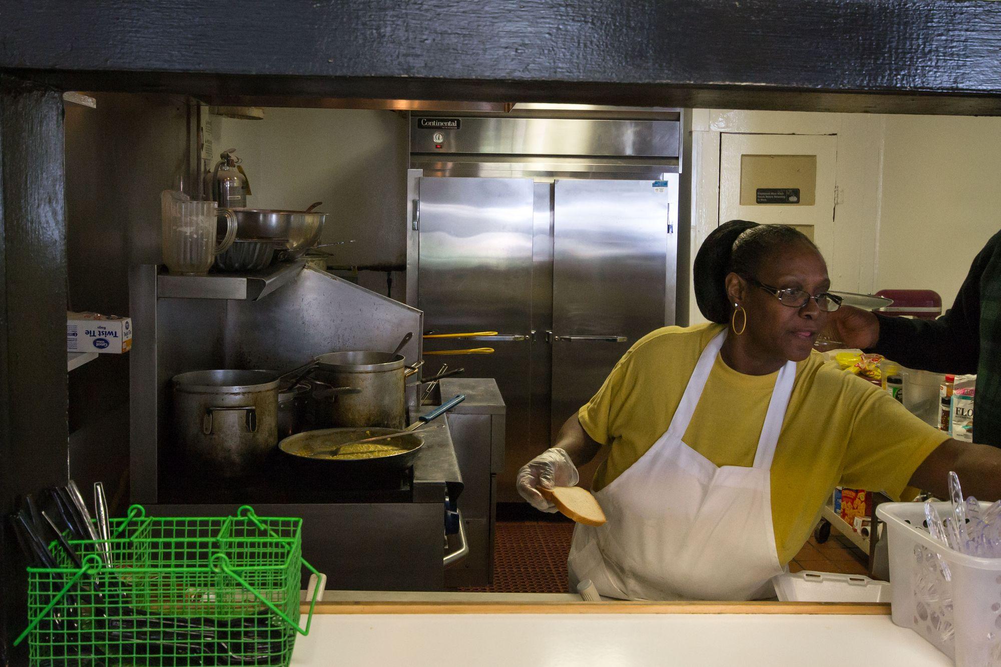 Weaver D's employee preparing food.