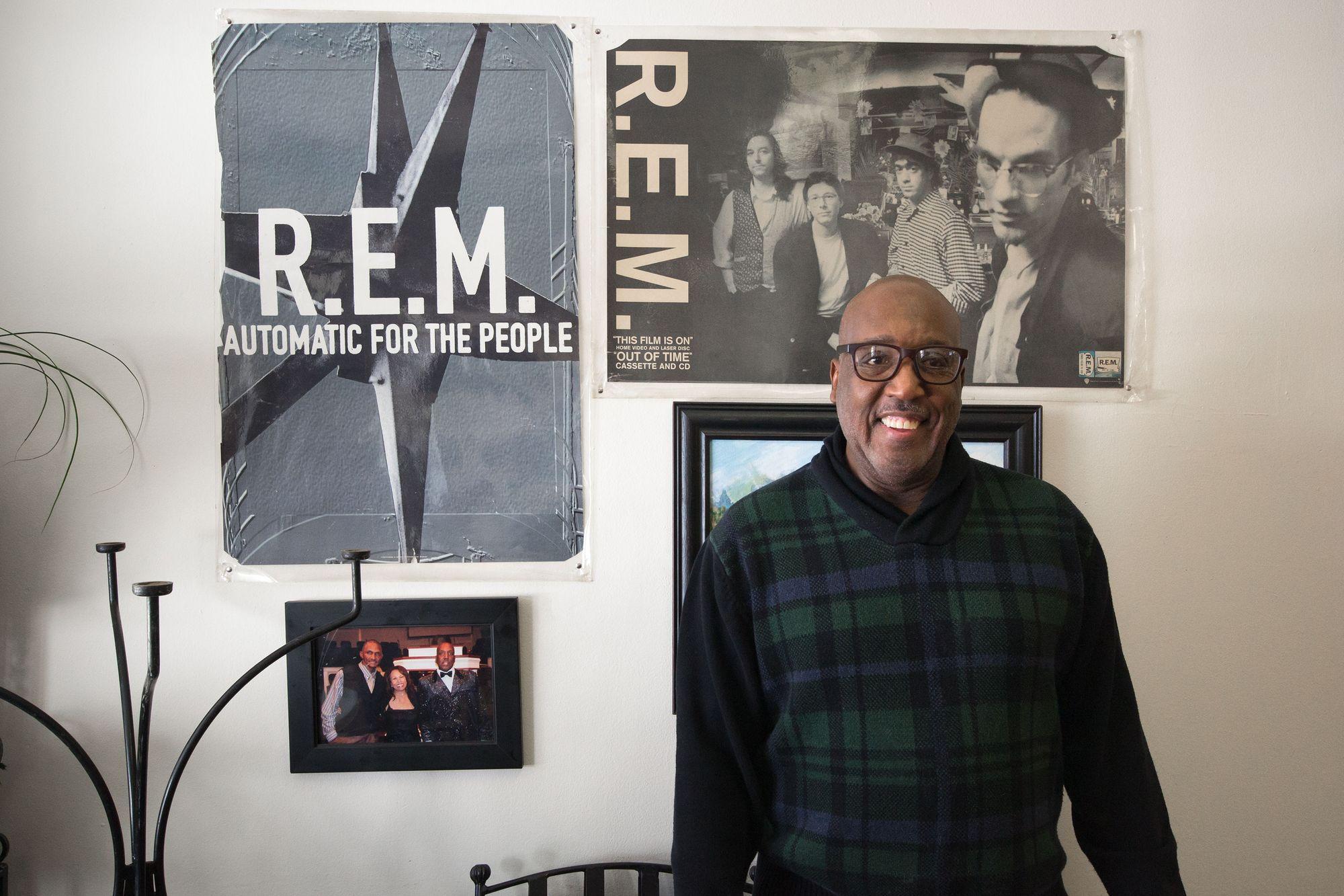Dexter Weaver in front of the R.E.M. album cover.