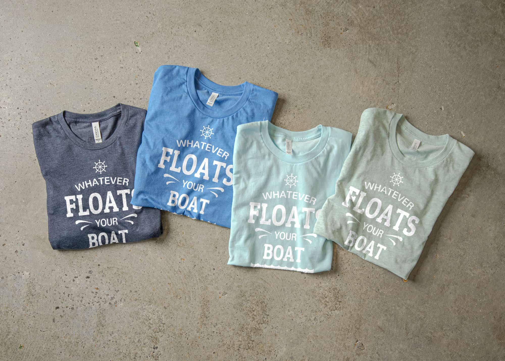 An arrangement of blue toned t-shirts.