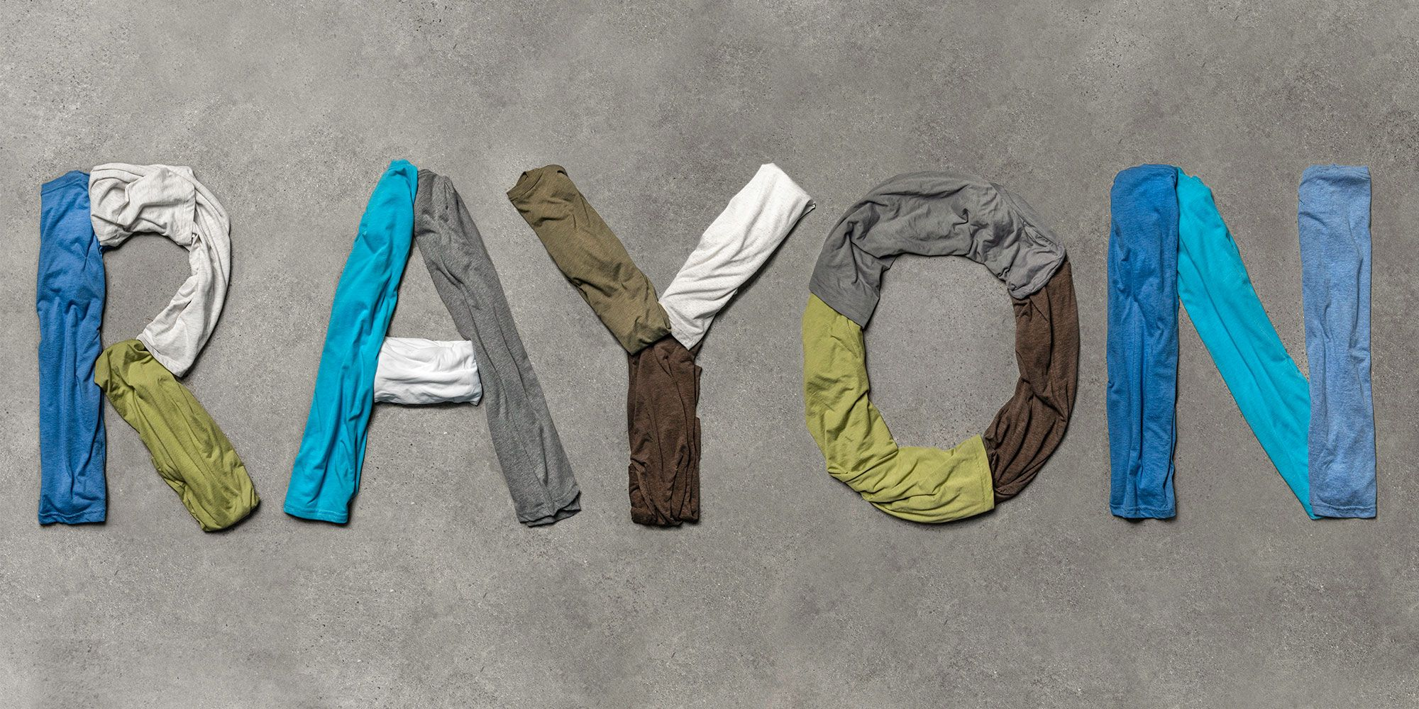 Flatlay image of t-shirts spelling out Rayon.