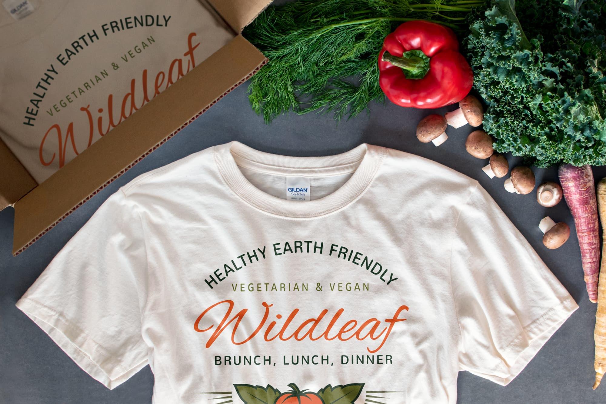 Flatlay showing restaurant receiving custom t-shirts.