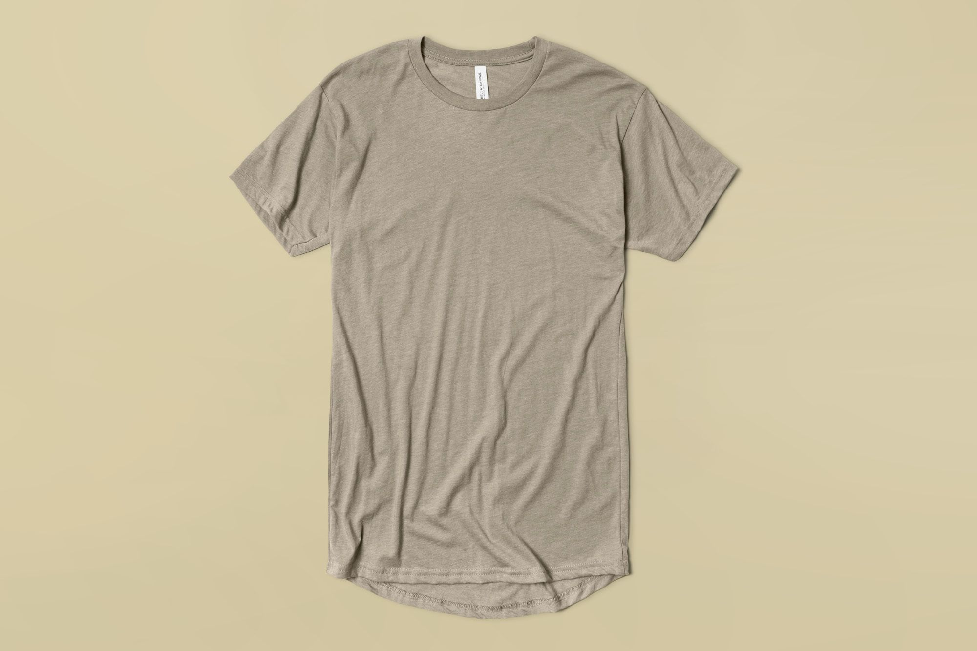 Flatlay showing t-shirt with curved hem bottom.