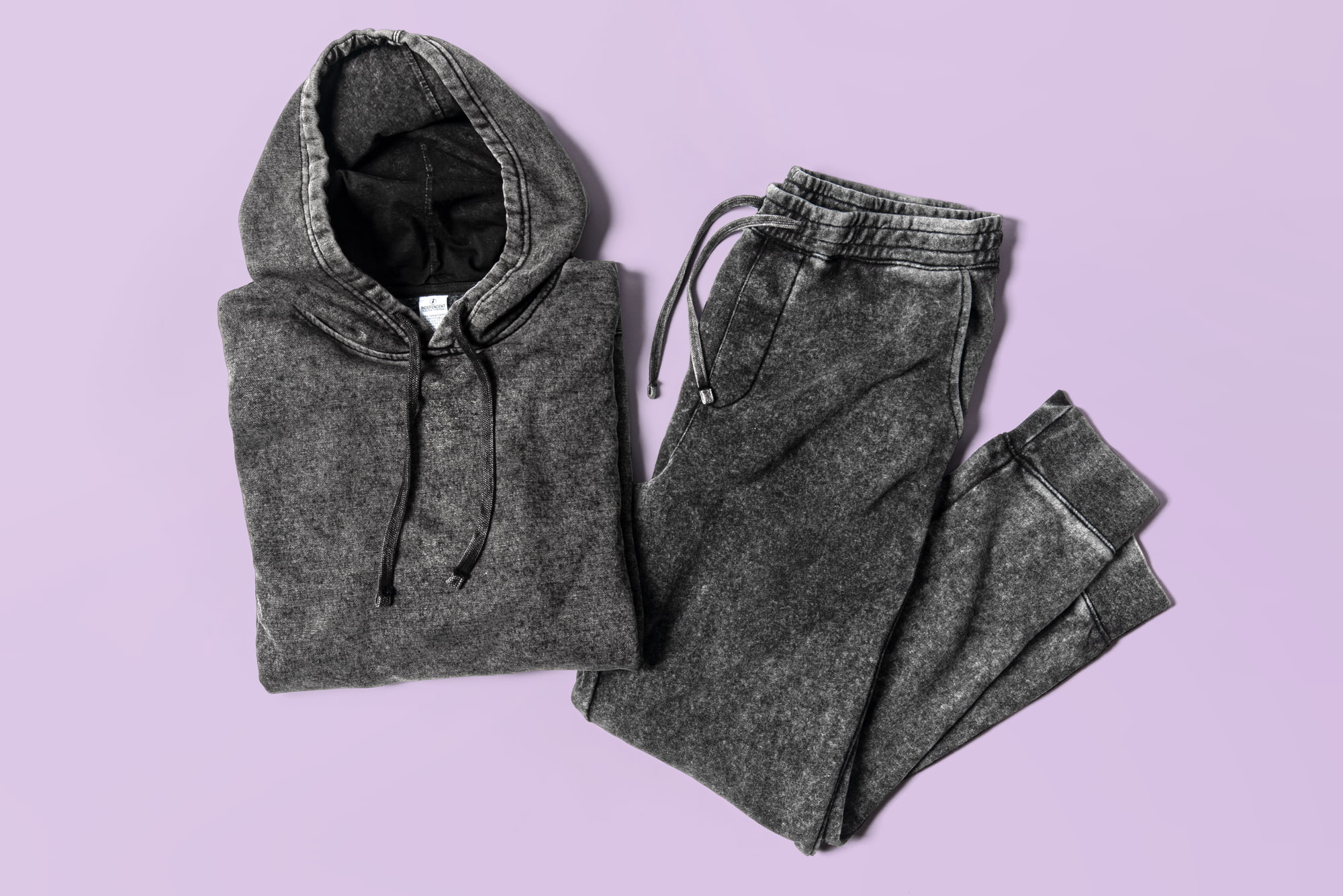 Flatlay image of mineral wash sweatpants and hoodie.
