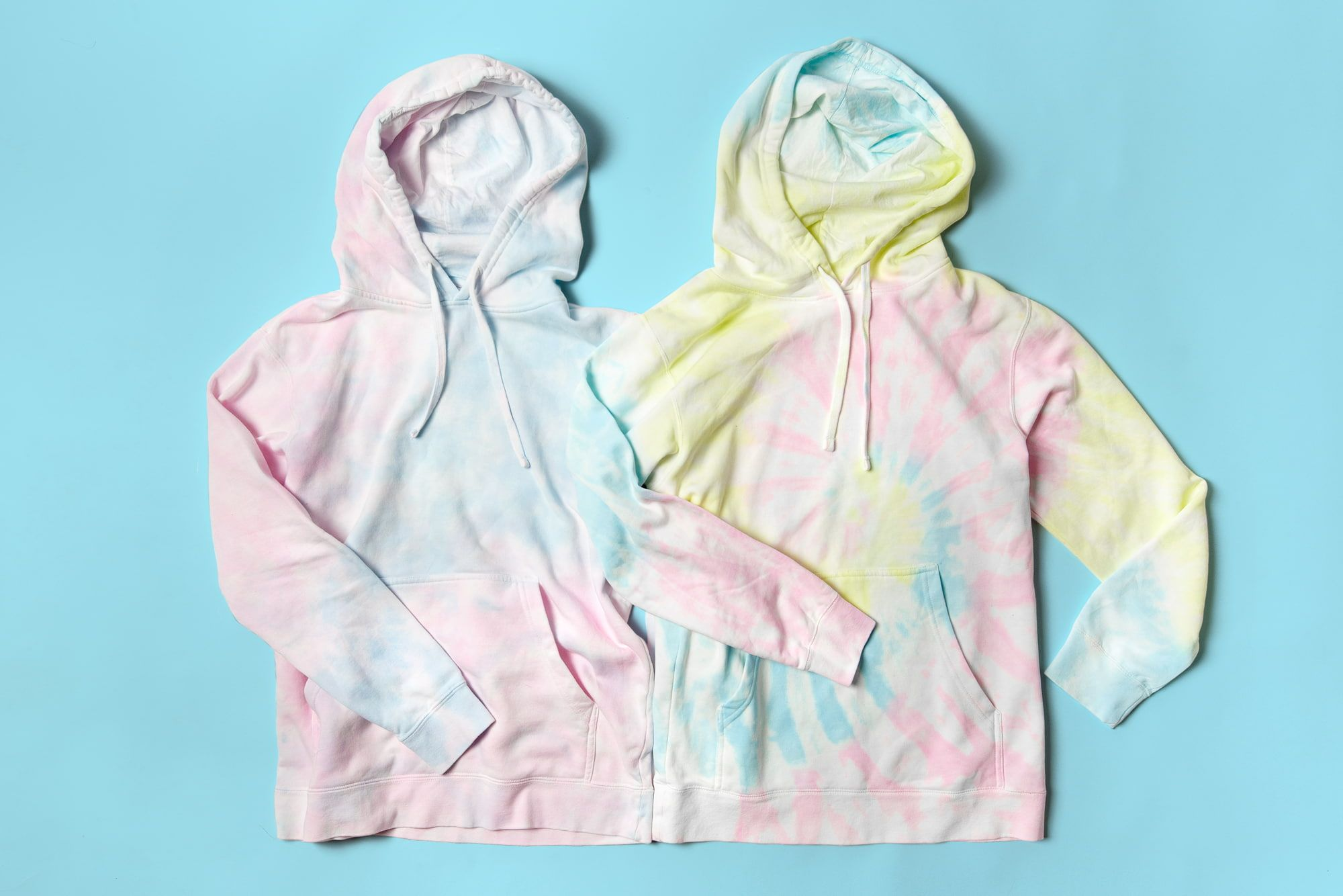 Flatlay image of two tie-dyed hoodies.