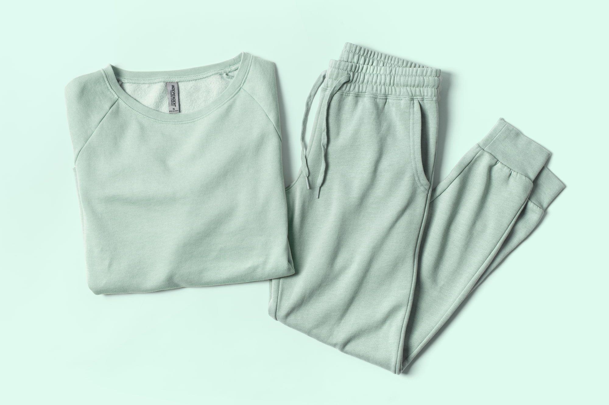Flatlay image of garment washed fleece sweatpants and sweatshirt.