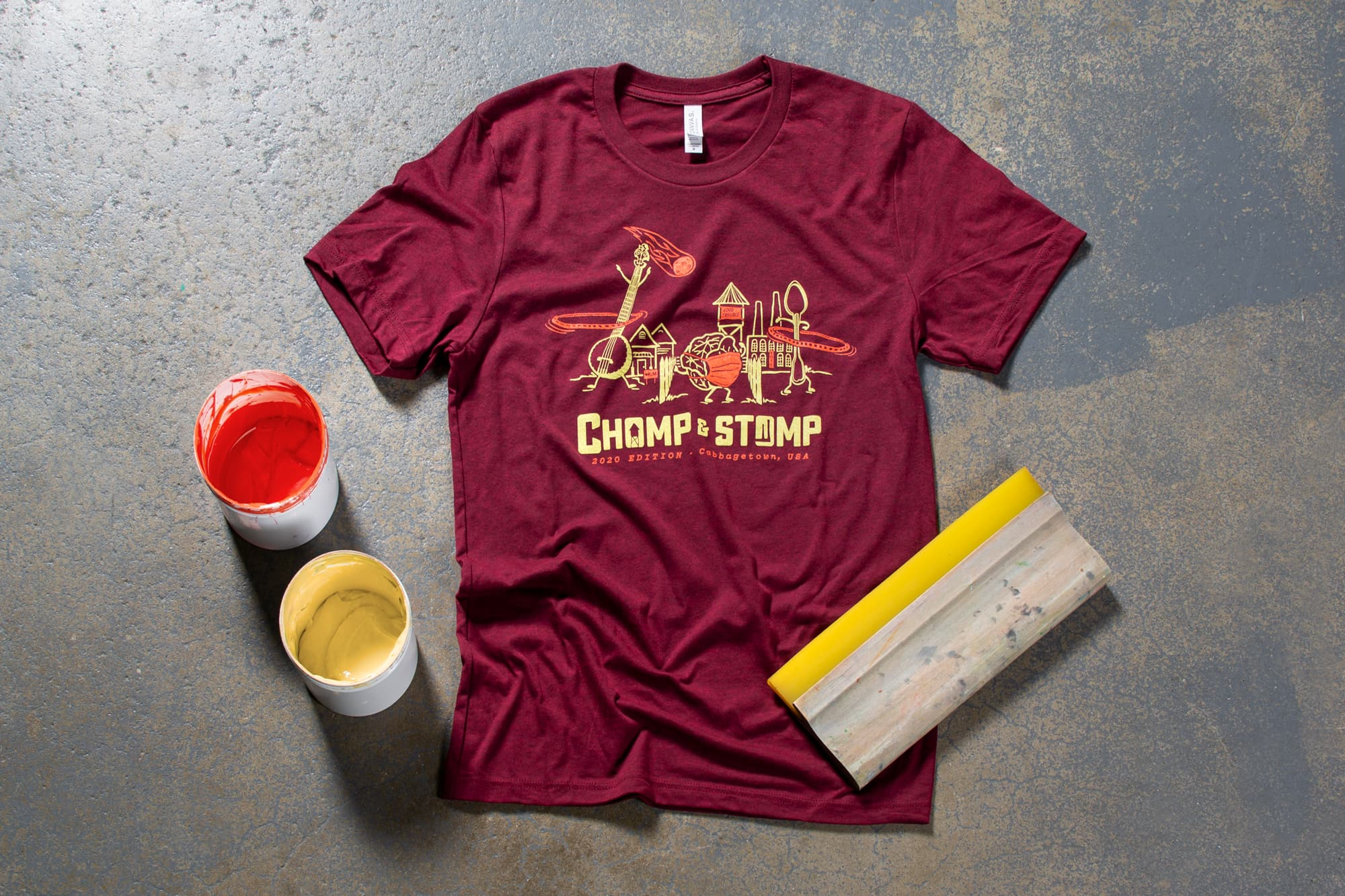 Flatlay image of Chomp and Stomp t-shirt.