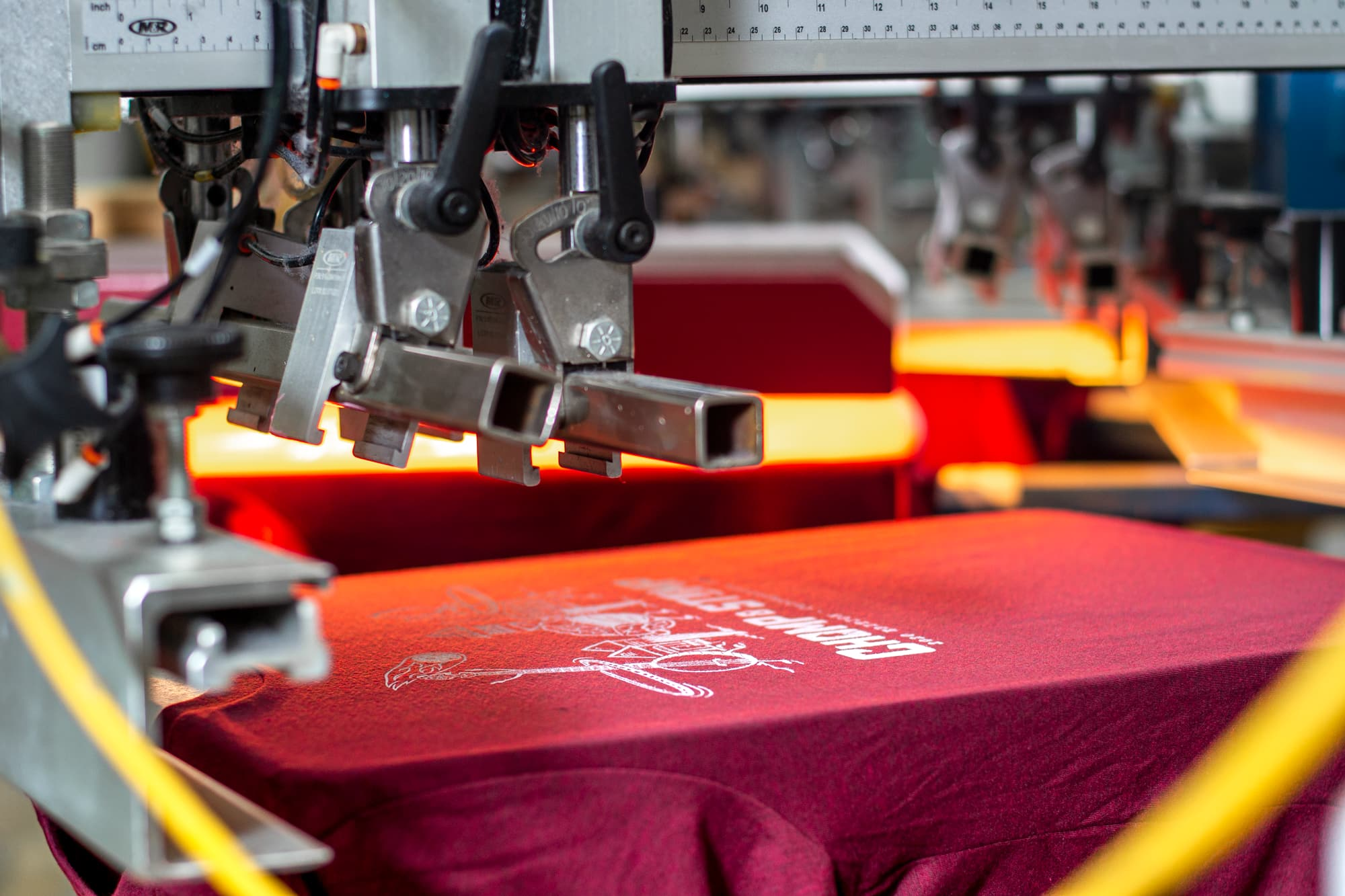 Another look behind the scenes at the Chomp and Stomp t-shirts being printed.