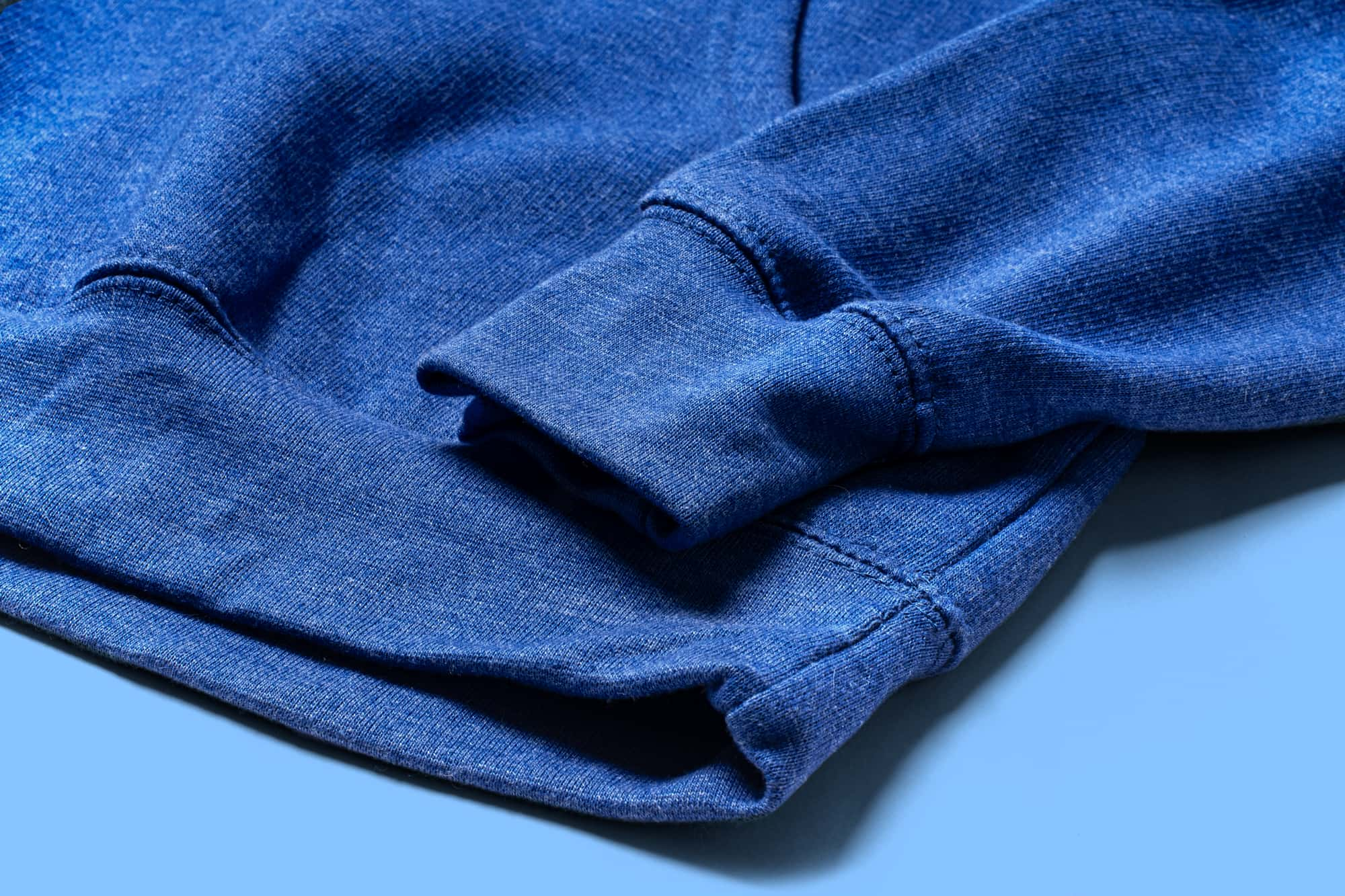 Detail of the bottom hem of the Independent Trading Pullover Hoodie.