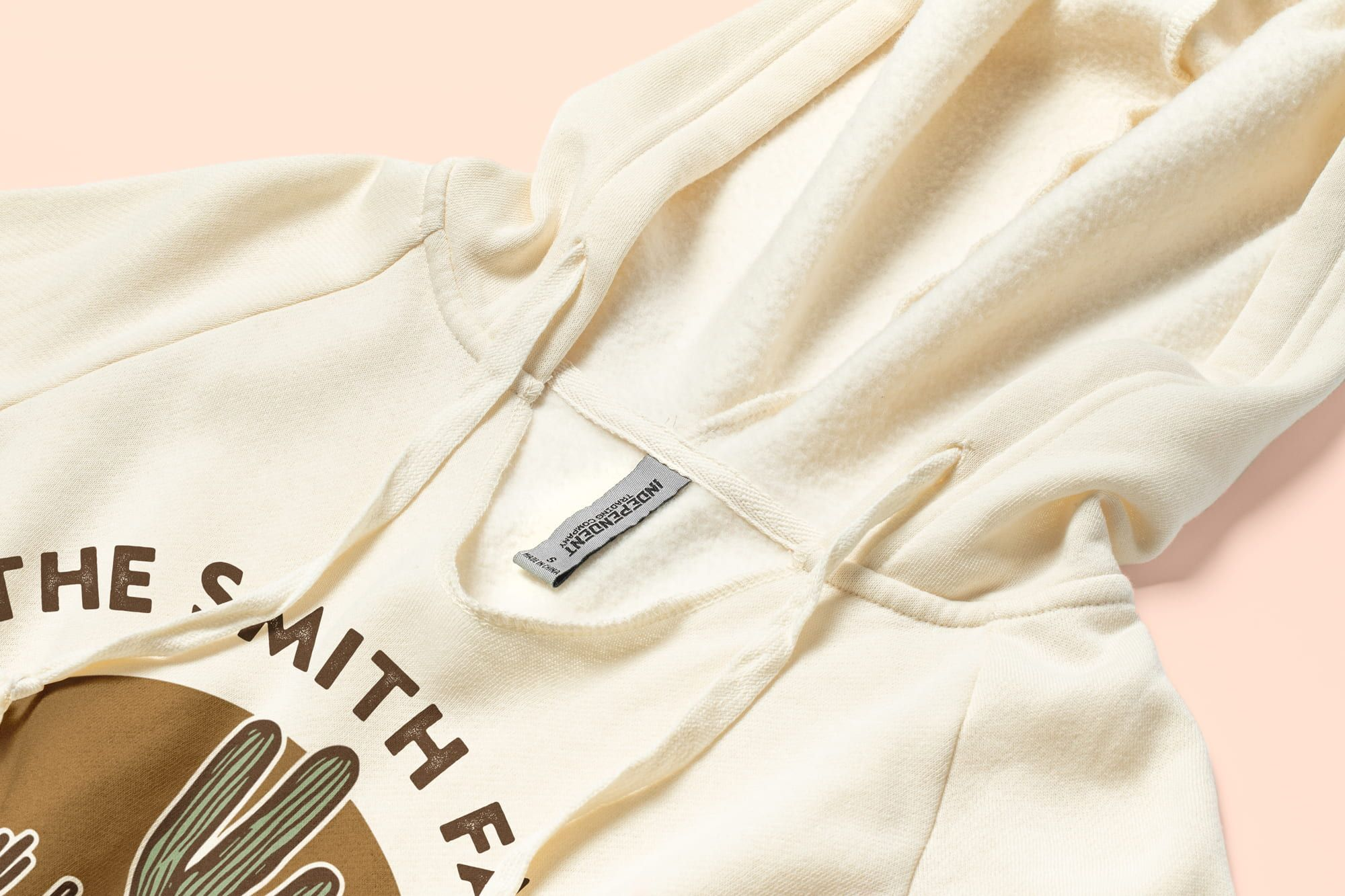 Detail of the v-neck and hood of the Independent Trading Ladies Lightweight Hooded Pullover.
