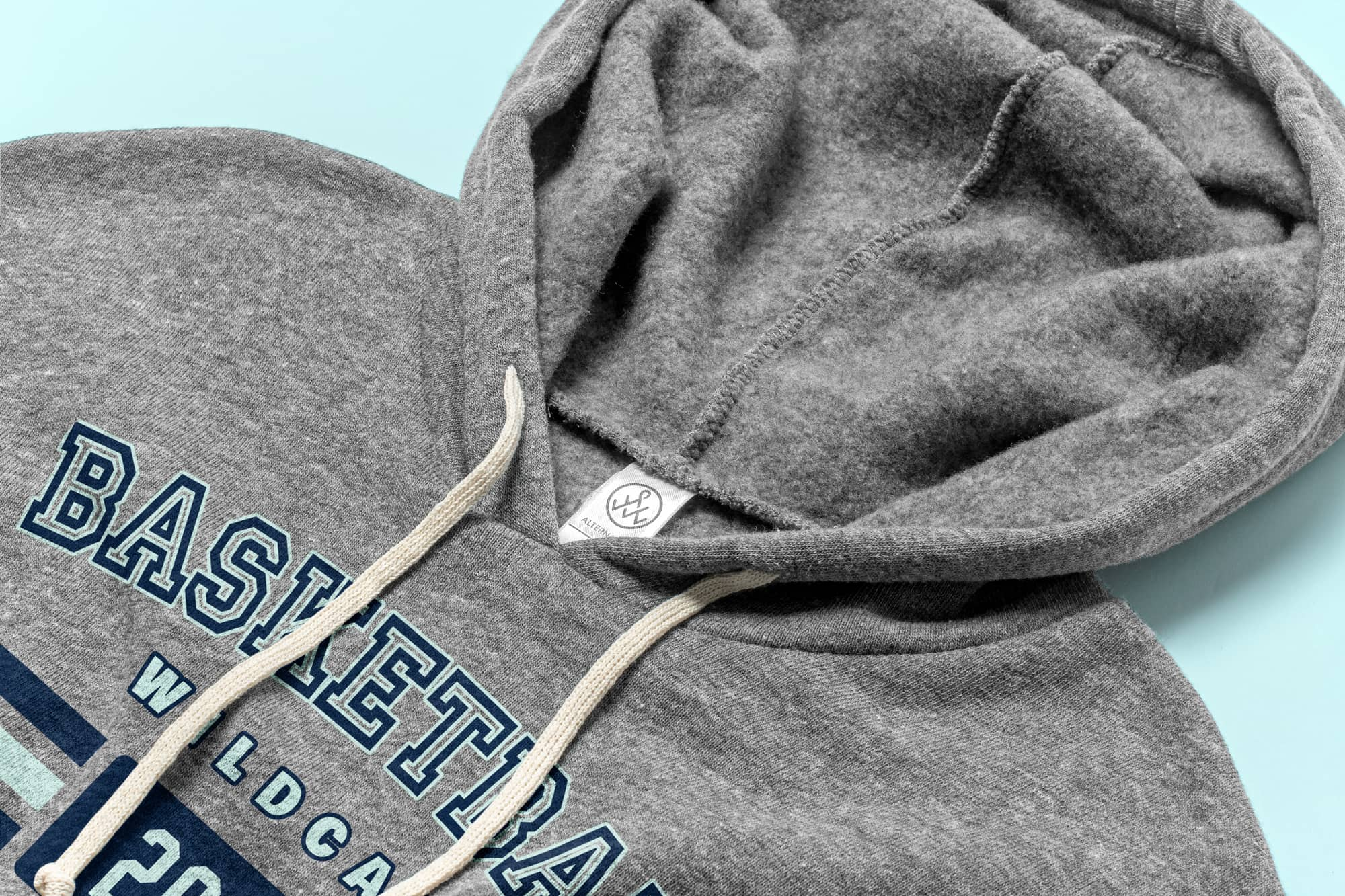 Detail of the drawstings and hood of the Alternative Apparel Challenger Hooded Pullover.