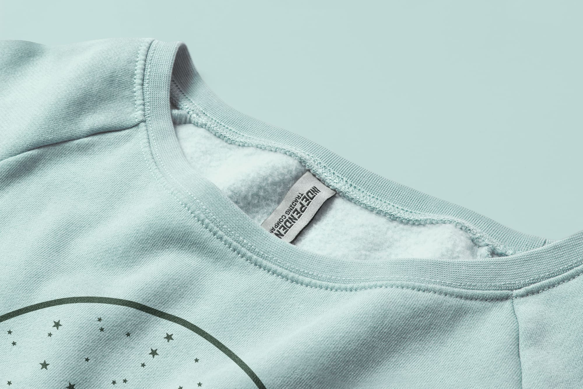 Detail of the collar of the Independent Trading Ladies Wave Wash Fleece Sweatshirt.