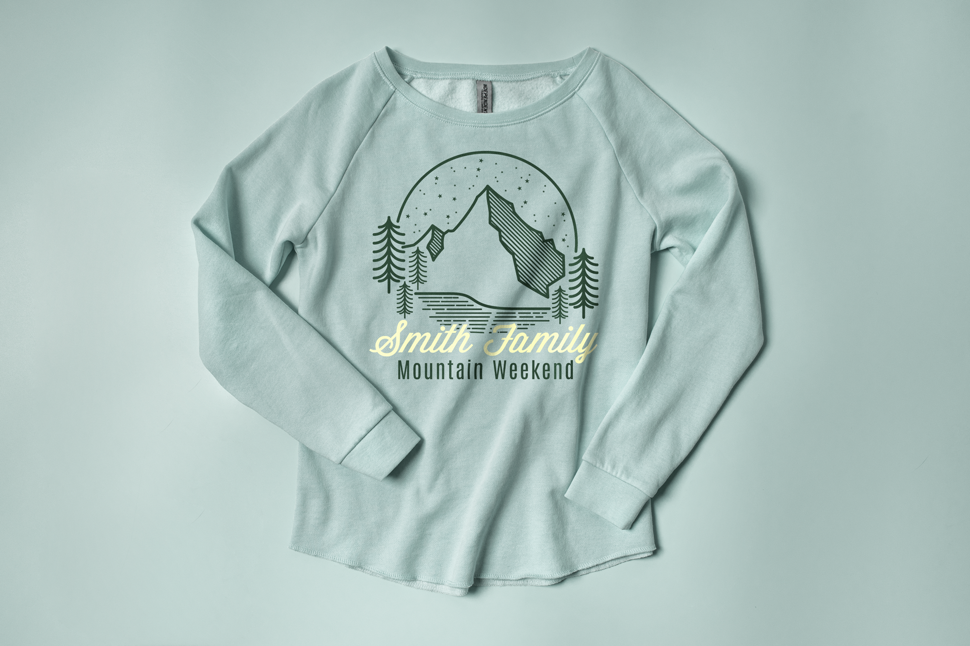 Flatlay of the Independent Trading Ladies Wave Wash Fleece Sweatshirt showing a custom family vacation design.