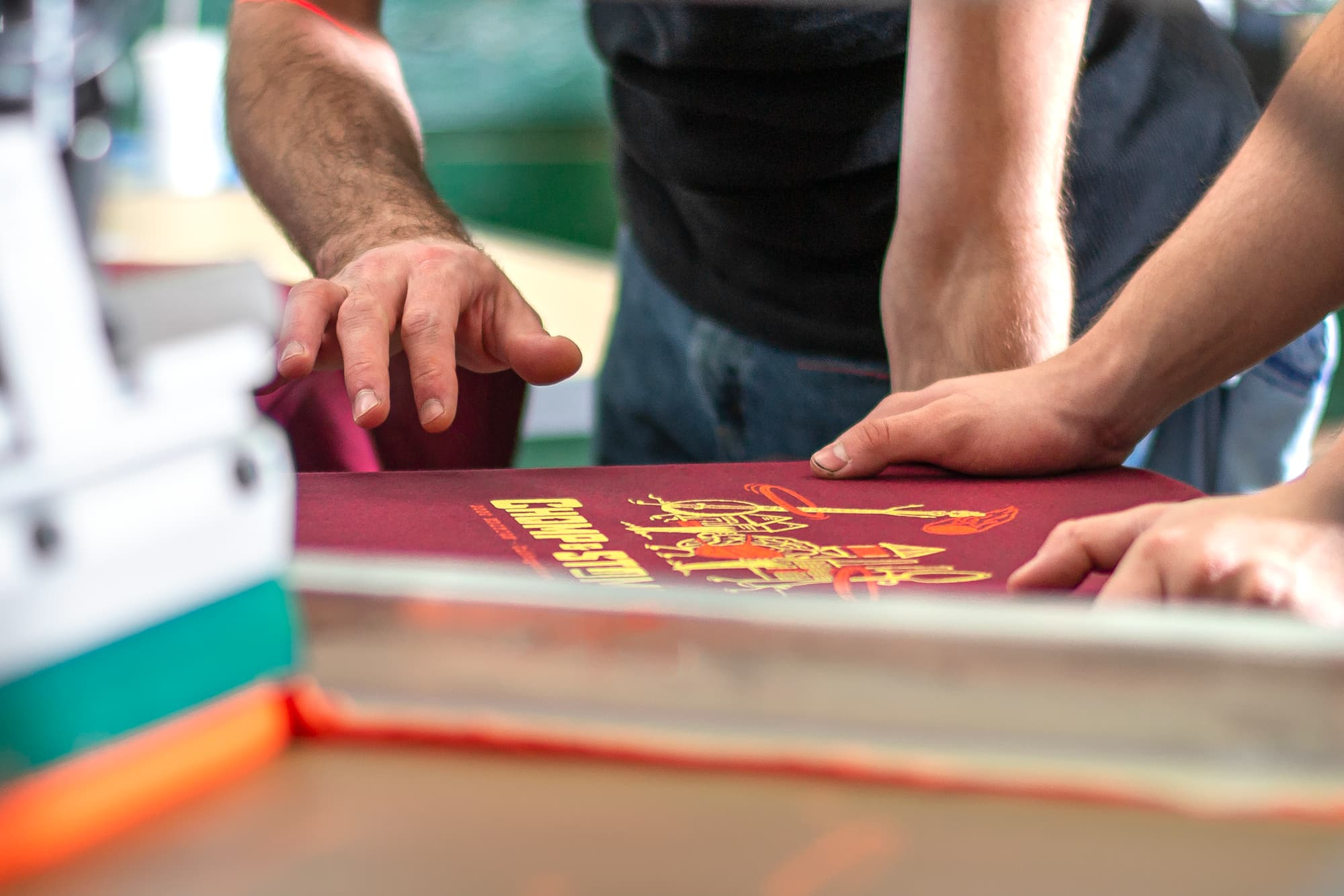 Image showing a behind the scenes look of our screen printers checking the accuracy of a customers order.